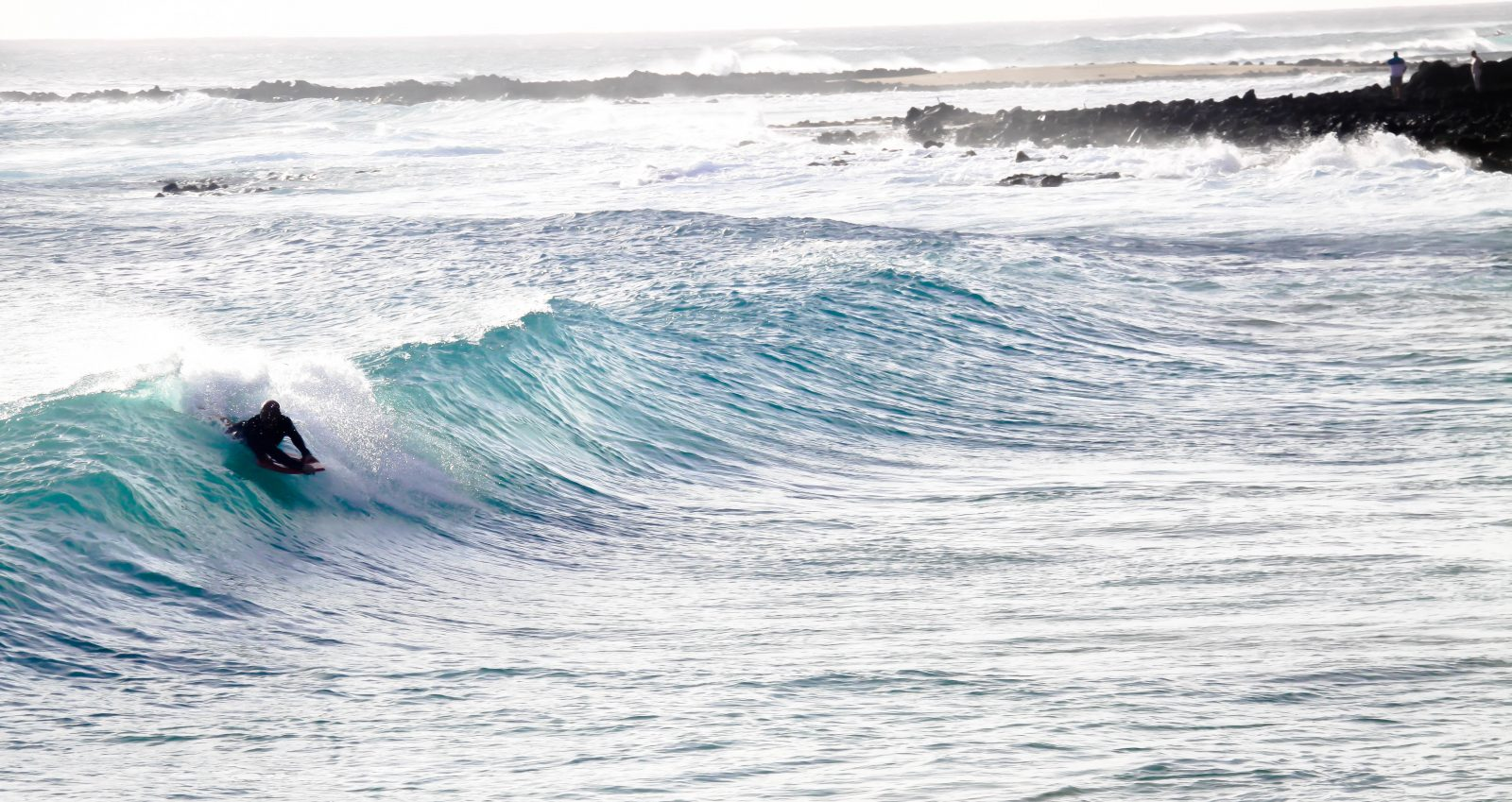 A local is catching some waves at Brennecke's Beach